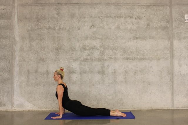 Read more about the article Prevent Back Pain With These Adjustments During Yoga + Free Video